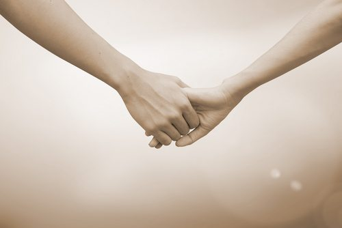 Hands Clasping Together